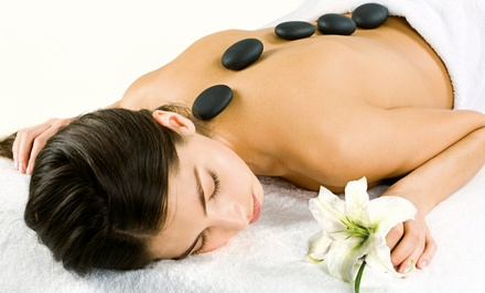 One or Three Hot-Stone Massages, or a Massage with an Herbal Footbath at Massage De Virginia (Up to 48% Off)