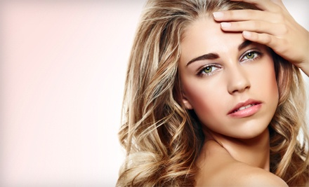 Haircut and Style with Optional Face-Framing Foils or Organic Perm at Salon Serenity (Half Off)