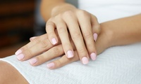Deluxe Manicure, Pedicure or Both with Exfoliation and Massage at Hands of Buddha (Up to 60% Off)