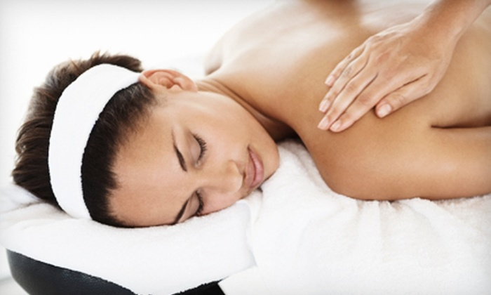 Works Of Wonder Massage - Trinity - Houston Gardens: 60-Minute Therapeutic Massage with Optional Hot Stones and Hot-Towel Facial at Works of Wonder Massage (Half Off)