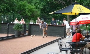 Nomad World Pub: Bocce Package for Four or Eight Including Beer and Pizza at Nomad World Pub (58% Off)