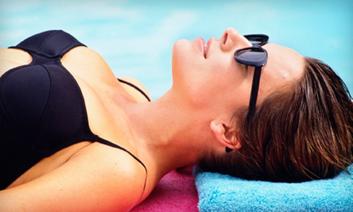 R U Tan - Multiple Locations: UV and Spray Tanning at R U Tan (Up to 65% Off). Three Options Available.