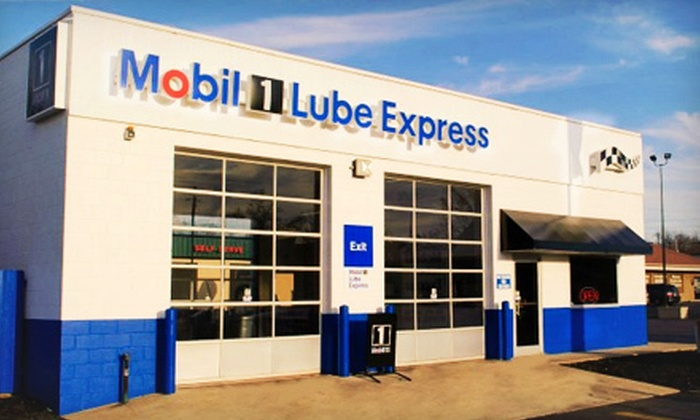 Mobil1 Lube Express - Multiple Locations: Oil Change or Car-Maintenance Package with Oil-System Cleaner and Wiper Blades at Mobil1 Lube Express (Up to 53% Off)
