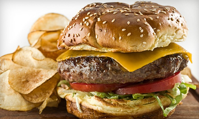 Wooden Nickel Sports Bar & Grill - Downtown Appleton: Pub Meal with Appetizer and Drinks for Two or Four or $7 for $15 Worth of Pub Fare at Wooden Nickel Sports Bar & Grill