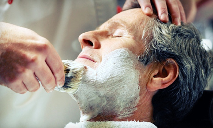 Roosters Men's Grooming Center - South Central Colleyville: $25 for Men's Haircut Package with Seven-Step Facial Shave at Roosters Men's Grooming Center in Colleyville ($52 Value)