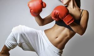 Chris Sutton's Martial Arts & Fitness: Two-Week or One-Month Kickboxing Package with Gloves and Wraps at Chris Sutton's Martial Arts & Fitness (81% Off)