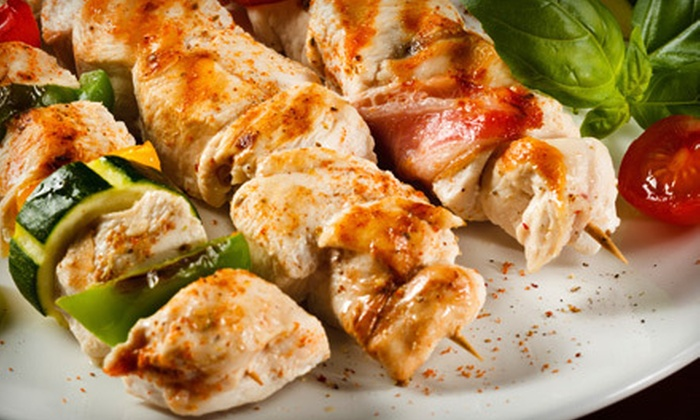 Yummy Grille by A-1 Pizza and Sub - Arbutus: Carryout Dinner with Entrees and Sides for Two or Four from Yummy Grille by A-1 Pizza and Sub (Up to 53% Off)