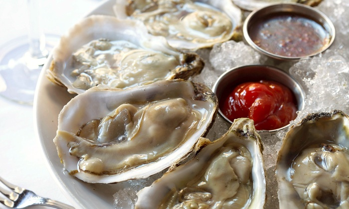 The Ice House Cafe - Herndon: One Dozen or Two Dozen Oysters or Clams with Options for Soup or Salad at The Ice House Cafe (Up to 53% Off)
