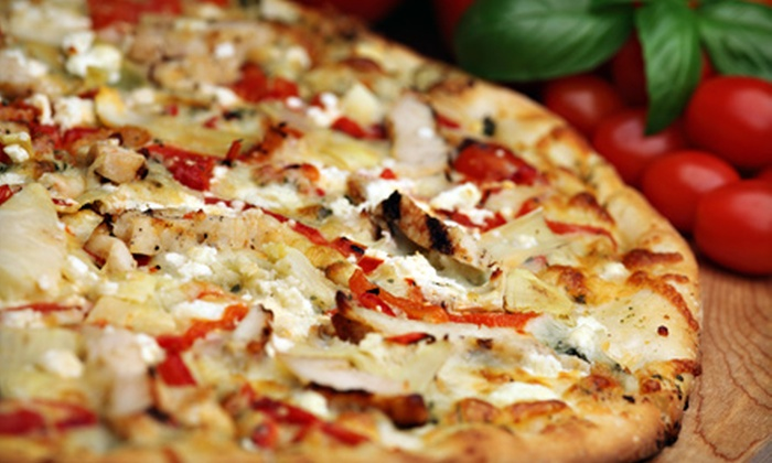 Cozmic Pizza - West Eugene: Pizza Meal for Two or Choice of Pizza and Drinks at Cozmic Pizza
