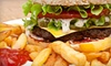 Coach's Pub and Grill - Holt: Two-Course Dinner for Four or $10 for $20 Worth of Pub Fare at Coach's Pub and Grill