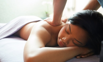 Massage with Foot or Body Scrub, or Two 60-Minute Aromatherapy Massages at The Massage Suite (Up to 70% Off)