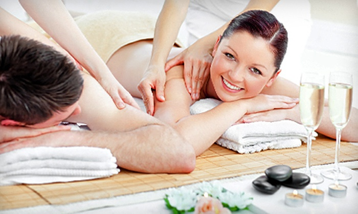 World of Health - North Beach: 60- or 90-Minute Couples Massage Packages with Champagne and Strawberries at World of Health (Up to 59% Off)