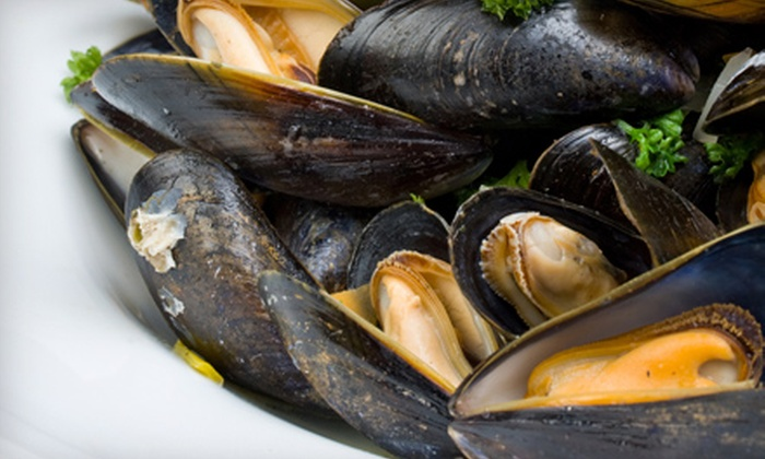 La Goulue - Bal Harbour: Unlimited Mussels and White Wine for One or Two at La Goulue (Up to 54% Off)