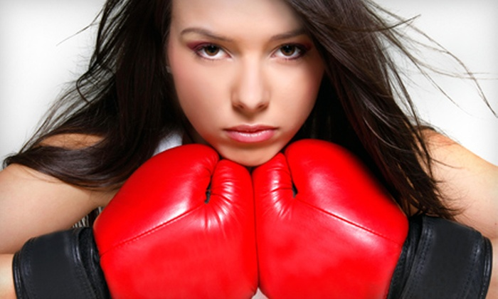 Mendez Boxing - Midtown South Central: $48 for Four Boxing Lessons at Mendez Boxing (Up to $100 Value)