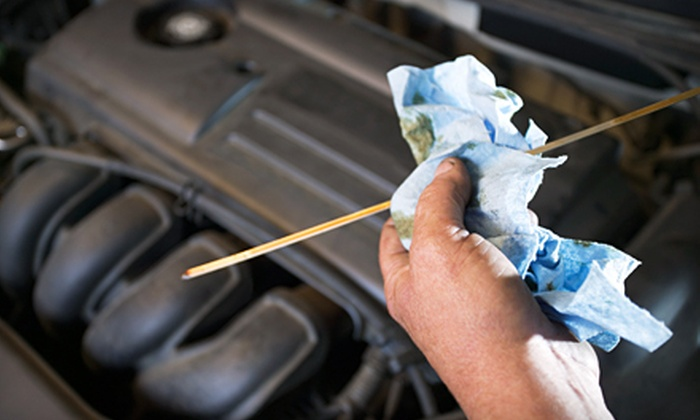 Meineke Car Care Center - Multiple Locations: $29 for Three Oil-Change Packages at Meineke Car Care Center ($130.50 Value)