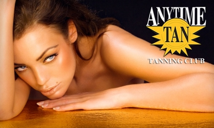 Anytime Tan Tanning Club - Multiple Locations: $27 for Two Spray Tans ($60 Value) or One Month of Unlimited Tanning ($59 Value) at Anytime Tan Tanning Club