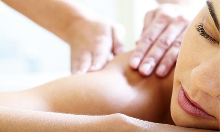 Looks Unlimited Salon & Day Spa - Central Rim: Massage or Hair Services at Looks Unlimited Salon & Day Spa