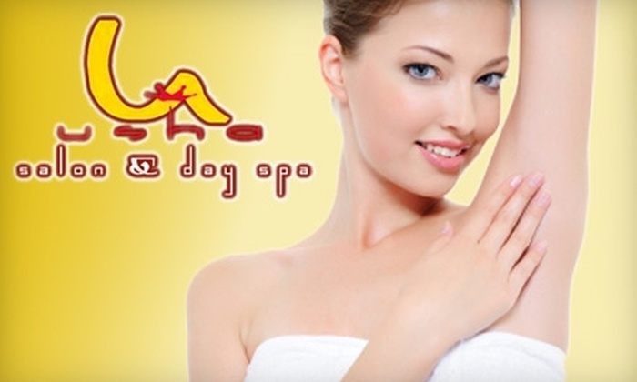 Usha Salon and Day Spa - Multiple Locations: $35 for $70 Worth of Waxing Services Plus Eyebrow Threading at Usha Salon and Day Spa ($82 Total Value). Choose From Two Locations.