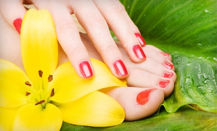 1 Natural Manicure and 1 Hydrotherapy Pedicure ($45 Value) - New Yorker Professional Styling Salon & Spa in Chicago