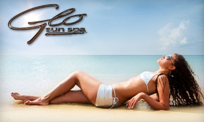 Glo Sun Spa - Multiple Locations: $26 for Two Hydration Station Sessions, Two Ultimate Versa Spa Spray Tan Sessions, and Two Lumiere Facials ($230 Value)