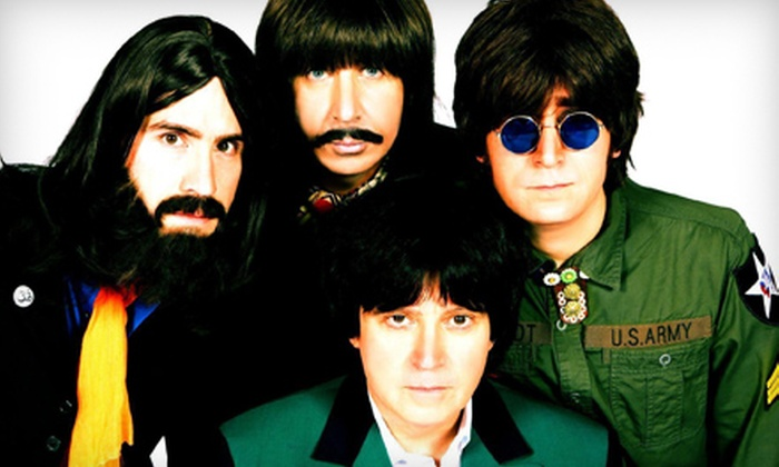 American English - Mojoes: $9 for American English Beatles Tribute Band and Drink at Mojoes on Friday, December 20, at 9 p.m. (Up to $17.30 Value)