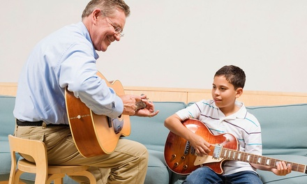 $29 for Four 30-Minute Guitar Lessons at Pauly's Productions ($65 Value)