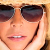 Up to 65% Off Airbrush Tanning at Sassi Salon