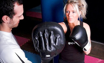 1 Year of Kickboxing Classes Including Registration Fee (a $1,550 value) - Absolute Boxing & Personal Training for Women in Dallas
