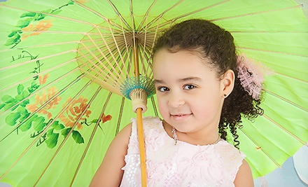 Photo-Shoot Package for Up to Four People with Prints or Digital Images at Punky Doodle Bugs Photography (Up to 61% Off)