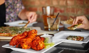 The Patio Restaurant & Sports Bar: Pizza and Wings from The Patio Restaurant & Sports Bar (Up to 48% Off). Three Options Available.