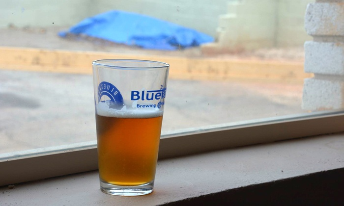 BlueTarp Brewing Co. - Decatur: Souvenir Package with Pint Glasses, Samples, and T-Shirts for 2 or 4 at BlueTarp Brewing Co. (Up to 42% Off)