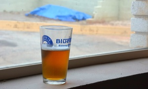 BlueTarp Brewing Co.: Souvenir Package with Pint Glasses, Samples, and T-Shirts for 2 or 4 at BlueTarp Brewing Co. (Up to 48% Off)