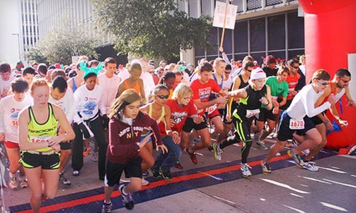 Total Jingle Bell Run & Walk - Downtown: Entry for 1, 2, or a Family of 4 to the Total Jingle Bell Run & Walk from YMCA of Greater Houston (Up to 63% Off)
