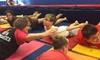 Us Too Kids - Multiple Locations: Four Weeks of Gymnastics Classes at Us Too Kids (56% Off)