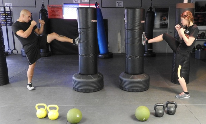 Rocky Mountain Self Defense & Fitness - Castle Rock: Four Weeks of Unlimited Boxing or Kickboxing Classes at Rocky Mountain Self Defense & Fitness (51% Off)