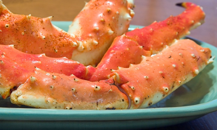 Supreme Fish Delight - Multiple Locations: Crab Legs or Shrimp with Soft Drinks and Sides for Two or Four at Supreme Fish Delight (Up to 53% Off)