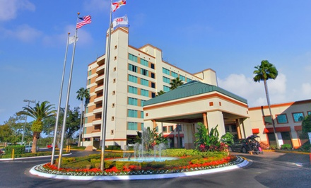 groupon daily deal - Stay at Ramada Gateway Hotel in Kissimmee, FL. Dates into August.