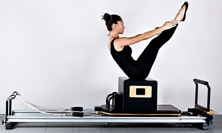 Pilates Group and Private Reformer Classes at aerialbodiesinc (Up to 64% Off). Three Options Available.
