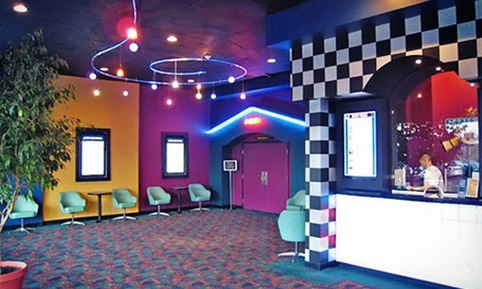Cinema Grill - Aurora: $15 for Two Movie Tickets, Two Drinks, and One Shared Appetizer at Cinema Grill (Up to $35.97 Value)
