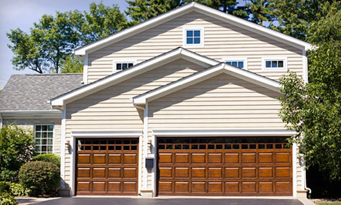 OKI Door Guys - Plainfield: Rubber-Sealant Replacement or Tune-Up and Inspection for One or Two Garage Doors from OKI Door Guys (Up to 67% Off)