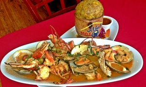 Mofongo's: Dominican and Caribbean Dinner with Drinks for Two or Four at Albert's Mofongo (Up to 59% Off)
