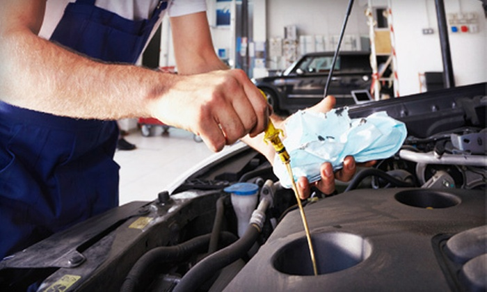 Maxim Muffler & Auto - Wolseley: $23 for an Oil-Change Package with Brake and Battery Inspections and Tire Rotation at Maxim Muffler & Auto ($150 Value)