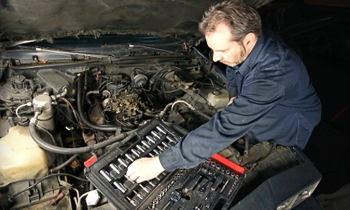 Newton Automotive - Katy Freeway Industrial Park: Oil Change, Coolant Flush, or Winterizing Package at Newton Automotive