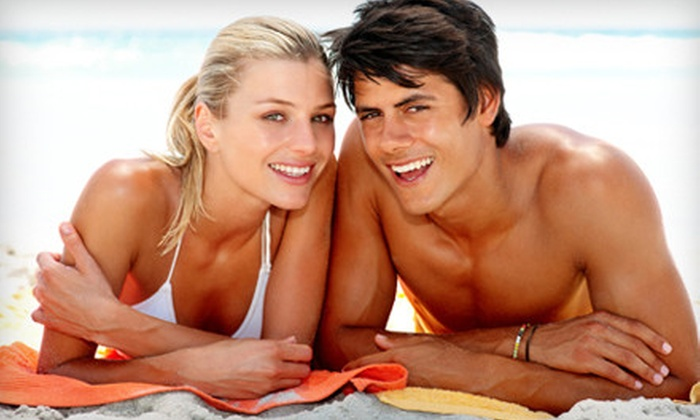 Salon Tropics - Shenandoah: One Month of Unlimited UV Tanning or Four Mystic Tans at Salon Tropics (Up to 66% Off)