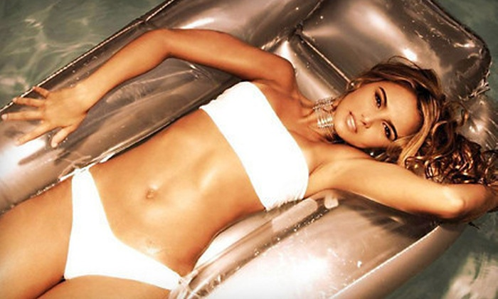 Tan 4 Life - Shelby Township: One or Three VersaSpa Spray Tans or One Month of Unlimited UV Tanning at Tan 4 Life (Up to 67% Off)