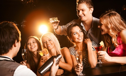 Table-Service Package with 1 Bottle of Liquor, Including Mixers and 1 Bottle of House Champagne (a $315 value) - Red Revolver Lounge in Scottsdale