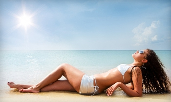 Halsted Tan and Spa - University Village / Little Italy: $30 for FIT Slimming Body Wrap ($75 Value) or $20 for Two VersaSpa Spray Tans (Up to $64 Value) at Halsted Tan and Spa