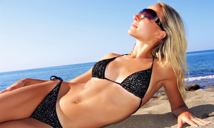 Malibu Tan - Multiple Locations: One Week of Unlimited Premier UV Tanning or Three VersaSpa Sunless Tans at Malibu Tan (Up to 88% Off)