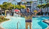 Mike Ditka's Runaway Beach Club Condo Resort - Runaway Beach: One-Night Stay for Up to Six at Mike Ditka's Runaway Beach Club Condo Resort in Kissimmee. Four Options Available.
