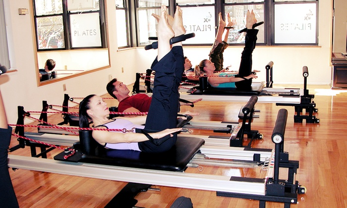 IM=X Pilates Studio NY - Midtown South Central: Four Semi-Private Pilates Reformer Classes or One Private Pilates Class at IM=X Pilates Studio NY (Up to 73% Off)